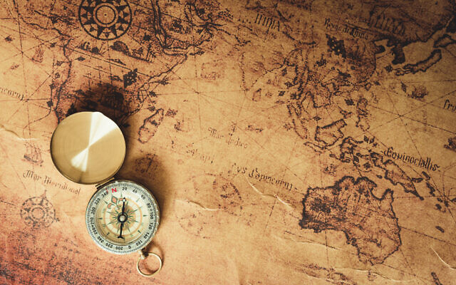 Illustrative picture of an old map and compass. (12963734/iStock by Getty Images)