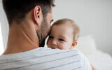 Illustrative: Father holding his baby girl at home. (Wavebreakmedia; iStock by Getty Images)