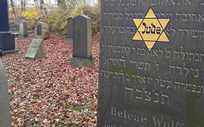 A Yello star sticker on a Jewish grave in Denmark on Nov. 10, 2019. (Courtesy of Rabbi Yitzi Loewenthal via JTA)