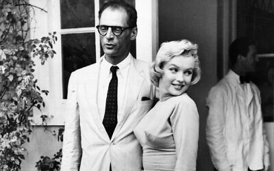 Arthur Miller and Marilyn Monroe in 1956. The playwright's parents bought a menorah for the film icon. (ullstein bild via Getty Images, via JTA)