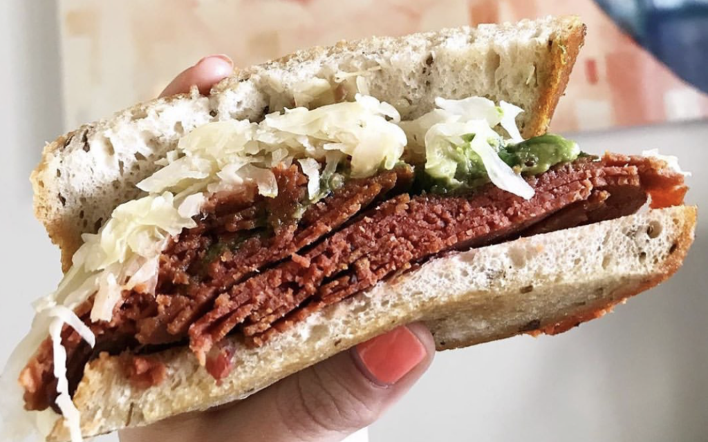An Unreal Deli vegan corned beef sandwich. (Courtesy Jenny Goldfarb/ Kathleen Lantos Photography)