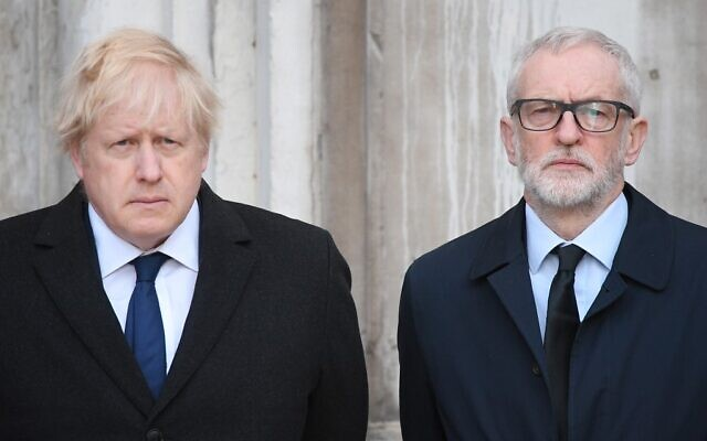 Britain's Prime Minister Boris Johnson (L) and opposition Labour party leader Jeremy Corbyn take part in a vigil at the Guildhall in central London to pay tribute to the victims of the London Bridge terror attack on December 2, 2019. (Daniel Leal-Olivas/AFP)