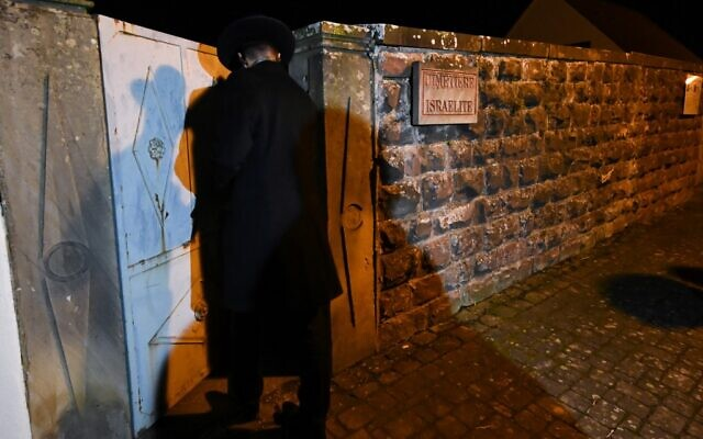 Jewish cemetery graves covered with swastikas and graffiti in France