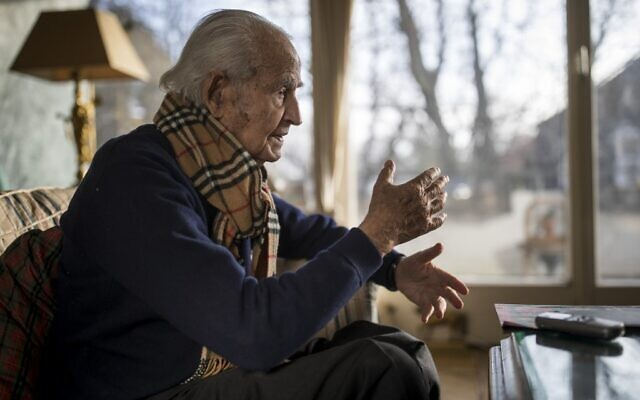 Holocaust survivor Leon Schwarzbaum speaks during an interview with AFP in his home in Berlin on December 4, 2019. (Odd Andersen/AFP)