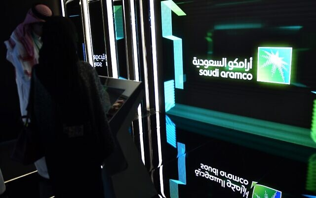 In this photo from November 13, 2019, visitors stop at the Aramco exhibition section at the Misk Global Forum on innovation and technology held in Riyadh, Saudi Arabia. (Fayez Nureldine/AFP)