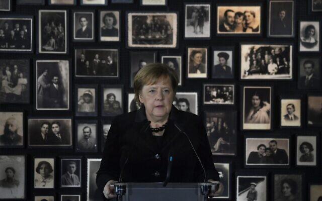 German Chancellor Angela Merkel delivers a speech during her visit at the former German Nazi death camp Auschwitz-Birkenau in Oswiecim, Poland on December 6, 2019. (John Macdougall/AFP)