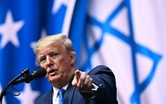 US President Donald Trump addresses the Israeli American Council National Summit 2019 at the Diplomat Beach Resort in Hollywood, Florida on December 7, 2019. (MANDEL NGAN / AFP)