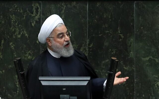 Iran's President Hassan Rouhani delivers a speech to present the budget for the financial year starting late March 2020 to the parliament in Tehran on December 8, 2019. (STR/AFP)