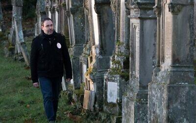 "Volunteer ""memory watcher"" Lionel Godmet patrols in the Jewish cemetery in Jungholtz, eastern France, on December 10, 2019. (SEBASTIEN BOZON/AFP)"