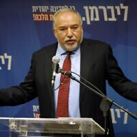 Yisrael Beitenu's party head Avigdor Liberman delivers a statement to the press on December 11, 2019 in Jerusalem. (Menahem KAHANA / AFP)