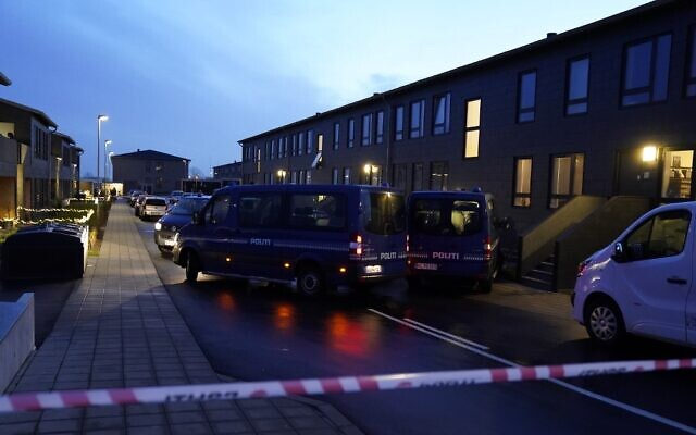 Police cars are parked in front of houses in Aalborg on December 11, 2019 during police action against suspected terrorists (Henning Bagger / Ritzau Scanpix / AFP)