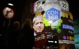 The broadcaster's exit poll results projected on the outside of the BBC building in London shows Britain's Prime Minister Boris Johnson's Conservative Party predicted to win 368 seats and a majority as the ballots begin to be counted in the general election on December 12, 2019. (Tolga Akmen / AFP)