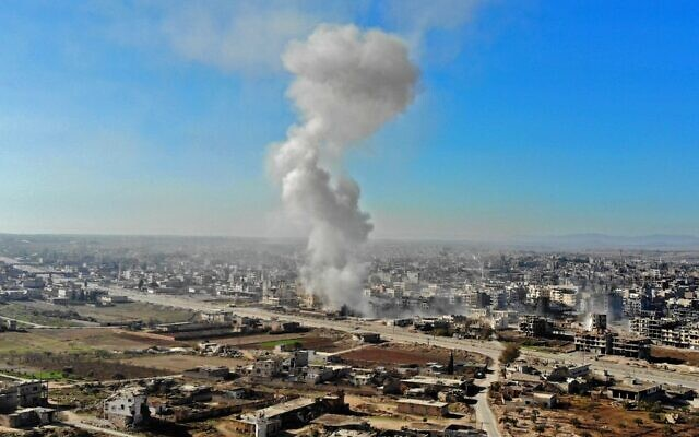 A smoke plume billows following a reported Syrian government air strike on a residential district of Maaret al-Numan in the northwestern Idlib province on December 18, 2019. (Omar HAJ KADOUR / AFP)
