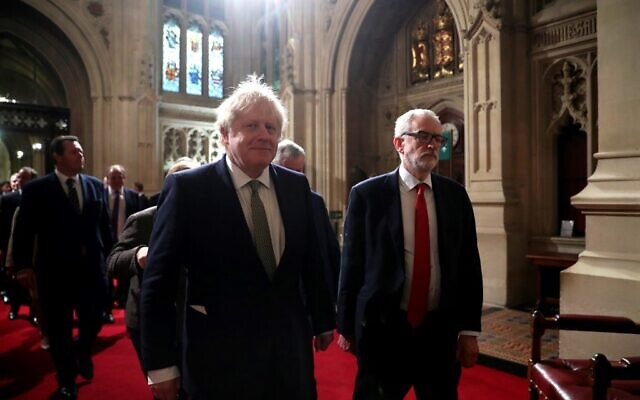 UK Prime Minister Boris Johnson (L) and Britain's Labour Party leader Jeremy Corbyn during the State Opening of Parliament at the Houses of Parliament in London on December 19, 2019. (HANNAH MCKAY/POOL/AFP)