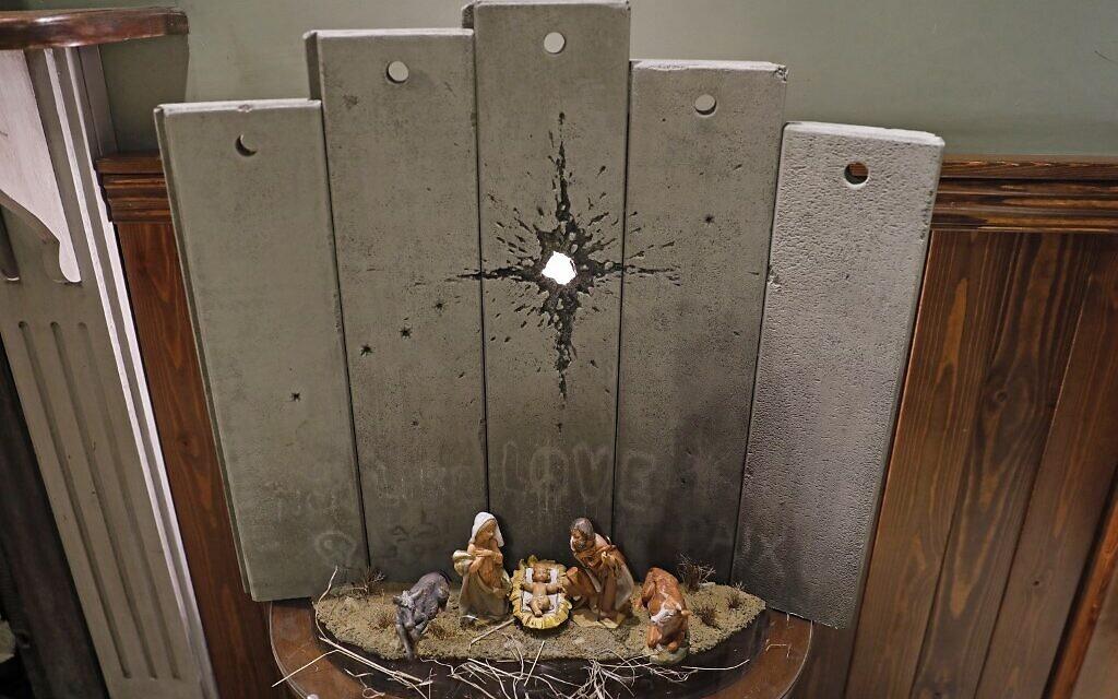 Bansky unveils dark nativity scene at his Bethlehem hotel