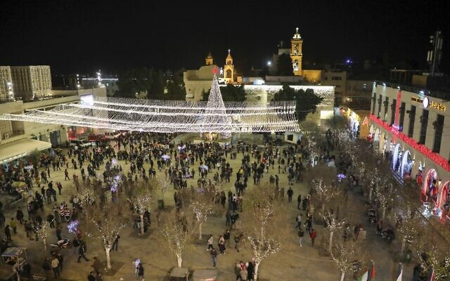 Tourists and pilgrims visit the Manger Square outside the Church of the Nativity in the biblical West Bank city of Bethlehem on December 24, 2019. (HAZEM BADER / AFP)