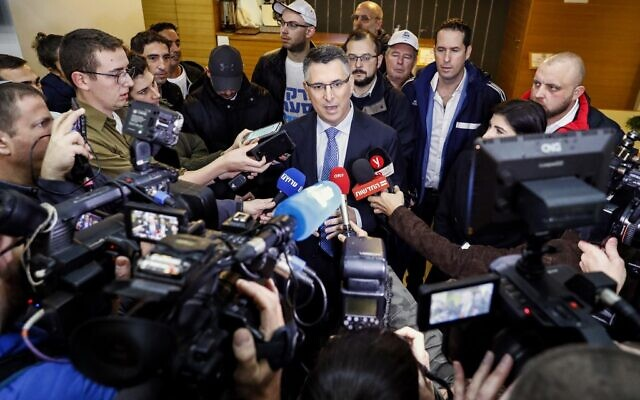 Gideon Sa'ar, Israeli Member of Knesset for Likud, speaks to the press after casting his ballot during a primary election vote to elect the party chairman, in the coastal city of Tel Aviv, on December 26, 2019. (JACK GUEZ / AFP)