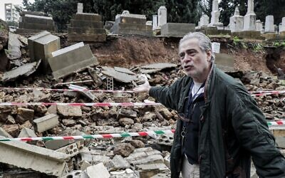 Nagi Georges Zeidan, an expert on the Jewish community in Lebanon and a volunteer at Jewish cemetery in the capital Beirut, inspects the site after several graves were damaged during bad weather in a winter storm on December 26, 2019. (Anwar Amro/AFP)