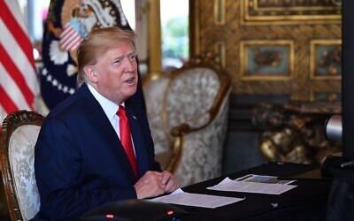 US President Donald Trump makes a video call to the troops stationed worldwide at the Mar-a-Lago estate in Palm Beach, Florida, December 24, 2019. (Nicholas Kamm / AFP)