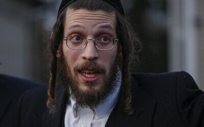 Josef Gluck talks to the press as he describes the machete attack that took place earlier outside a rabbi's home during the Jewish festival of Hanukkah in Monsey, New York, on December 29, 2019. (Photo by Kena Betancur / AFP)