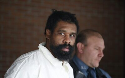Suspect in Hanukkah celebration stabbings Grafton Thomas, 37, from Greenwood Lake,  leaves the Ramapo Town Hall in Airmont, New York after being arrested on December 29, 2019. (Kena Betancur/AFP)
