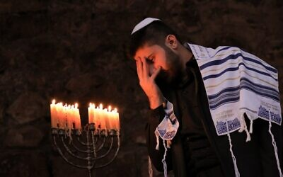A member of Iraq's Kurdish Jewish community takes part in a ceremony on the last night of the Jewish holiday of Hanukkah in the Iraqi town of Al-Qosh, December 29, 2019. (SAFIN HAMED / AFP)