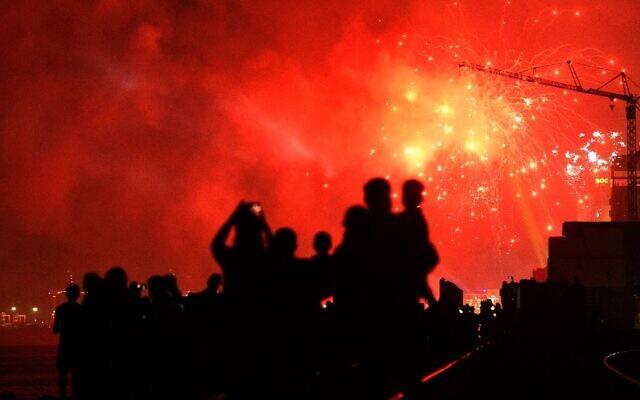 Sri Lankans watch fireworks during new year's celebrations in Colombo, on January 1, 2020. (Ishara S. Kodikara/AFP)