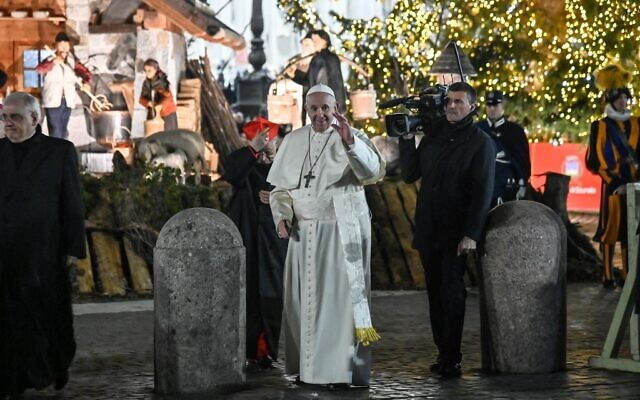 Pope Francis (C) waves to faithful as he visits the Nativity scene in Saint Peter's Square, following the 'Te Deum' prayer for the year 2019, in St Peter's Basilica at the Vatican, December 31, 2019. (Andreas Solaro/AFP)