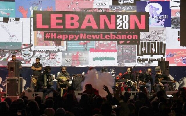 """Lebanese band """"The Great Departed"""" performs during new year's celebrations in downtown Beirut on December 31, 2019. (Anwar Amro/AFP)"""