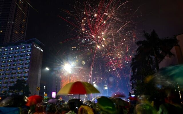 Fireworks erupt over the Hotel Indonesia, in Jakarta during New Year's celebrations on January 1, 2020. (Bay Ismoyo/AFP)