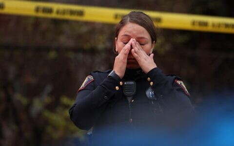 A Jersey City police officer reacts at the scene of a shooting that left multiple people dead on December 10, 2019, in Jersey City, New Jersey. (Rick Loomis/Getty Images/AFP)