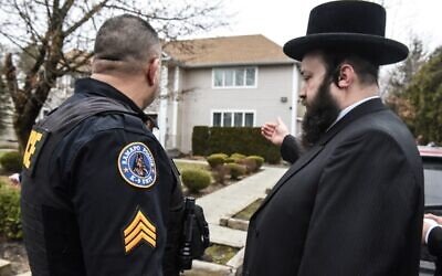 A member of the Ramapo police stands guard in front of the house of Rabbi Chaim Rottenberg on December 29, 2019, in Monsey, New York. (Stephanie Keith/Getty Images/AFP)