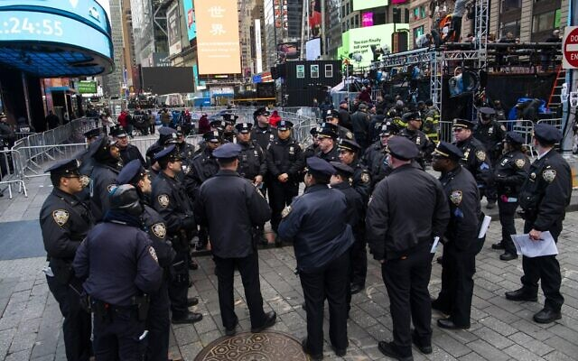 NYPD officers are briefed as people arrive to celebrate New Years eve in Times Square on December 31, 2019, in New York City. (Eduardo Munoz Alvarez/Getty Images/AFP)