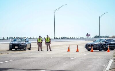 Florida state troopers block traffic over the Bayou Grande Bridge leading to the Pensacola Naval Air Station following a shooting on December 6, 2019, in Pensacola, Florida. (Josh Brasted/Getty Images/AFP)