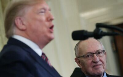Law Professor Alan Dershowitz, right, listens to US President Donald Trump speak during a Hanukkah Reception in the East Room of the White House in Washington, DC, December 11, 2019.   (Mark Wilson/Getty Images/AFP)