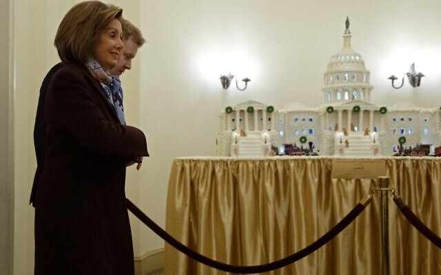 Speaker of the House Nancy Pelosi (D-CA) walks past a gingerbread model of the U.S. Capitol as she arrives at the capitol along side her Press Secretary Drew Hammill December 18, 2019 in Washington, DC. The House is scheduled to vote on two articles of impeachment against President Donald Trump later in the day.  (Chip Somodevilla/Getty Images/AFP)