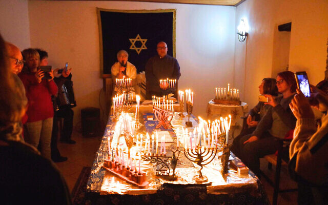 In this undated photo from recent years, Jews celebrate Hanukkah at Sinagoga Ner Tamid del Sud in Calabria, the first active synagogue since the area's Jews were expelled in the Inquisition 500 years ago. (Courtesy Rabbi Barbara Aiello)