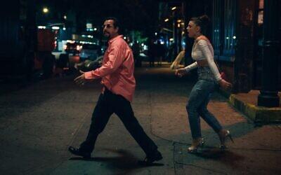 Adam Sandler as Howard Ratner and Julia Fox as Julia in 'Uncut Gems,' by Josh and Benny Safdie. (Courtesy)