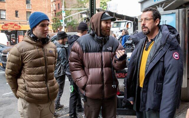 From left, Benny Safdie, Josh Safdie and Adam Sandler on the set of 'Uncut Gems.' (Courtesy)
