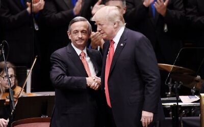 President Donald Trump is greeted by Pastor Robert Jeffress at the Celebrate Freedom Rally at the John F. Kennedy Center for the Performing Arts in Washington, July 1, 2017. (Olivier Douliery/Pool/ Getty Images via JTA)