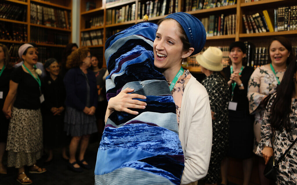 Rabbanit Jenna Englender dances with the Torah during her graduation ceremony from Yeshivat Maharat in New York, June 17, 2019. (Shulamit Seidler-Feller/Maharat/via JTA)