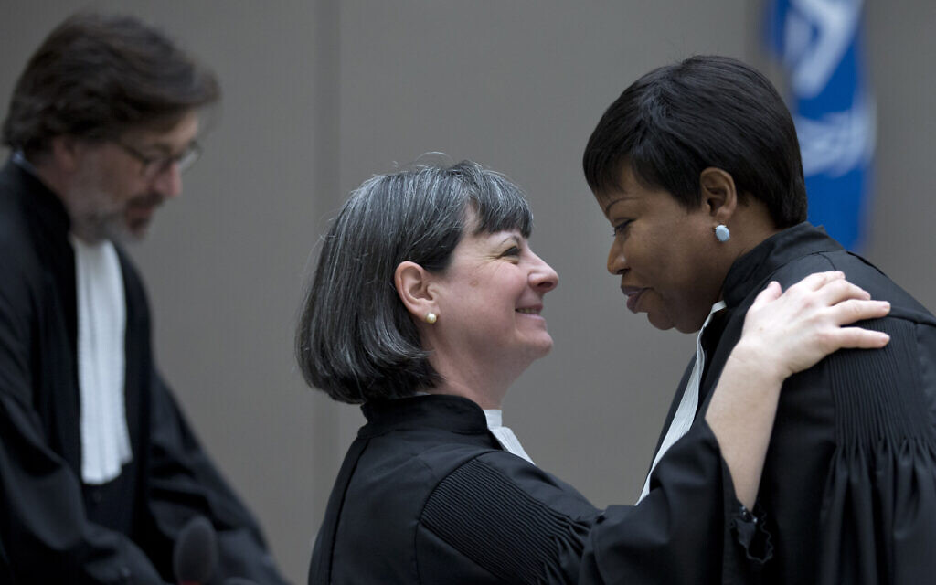 Fatou Bensouda, right, and attorney Paolina Massidda wait for the start of a trial against former Ivory Coast officials at the International Criminal Court in The Hague, the Netherlands, January 28, 2016. (Peter Dejong/AFP via Getty Images/ via JTA)