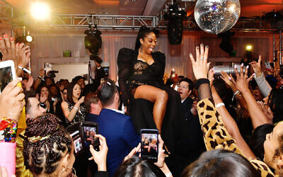 There was much rejoicing at Tiffany Haddish's bat mitzvah in Beverly Hills, California, December 3, 2019. (Emma McIntyre/Getty Images for Netflix via JTA)