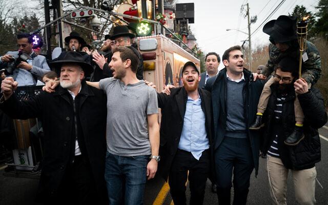 Revelers celebrate a new Torah scroll in Monsey, New York, December 29, 2019. (Luke Tress/Times of Israel)