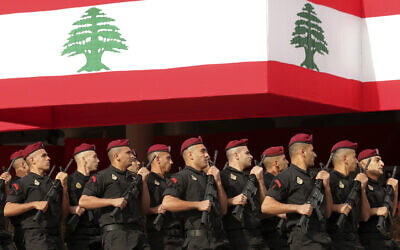 Lebanese marine special forces soldiers march during a military parade to mark the 76th anniversary of Lebanon's independence from France at the Lebanese Defense Ministry, in Yarzeh near Beirut, Lebanon, November 22, 2019. (Hassan Ammar/AP)