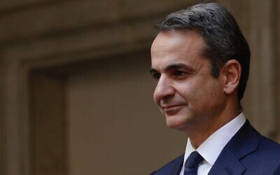 Greek Prime Minister Kyriakos Mitsotakis arrives for a meeting with Italian Premier Giuseppe Conte at the Chigi Palace premier's office in Rome, November 26, 2019. (AP Photo/Andrew Medichini)
