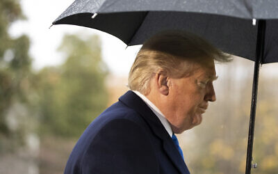 US President Donald Trump walks to Marine One after speaking with reporters on the South Lawn of the White House before departing, December 2, 2019, in Washington. (AP Photo/Alex Brandon)