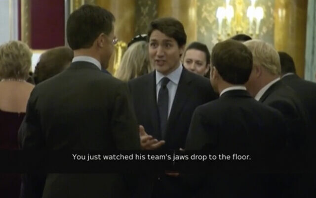 Screen capture from video of Canadian Prime Minister Justin Trudeau (C), standing in a huddle with French President Emmanuel Macron (C-R), British Prime Minister Boris Johnson,(R), Dutch Prime Minister Mark Rutte (C-L), and Britain's Princess Anne, during a NATO reception party at Buckingham Palace, December 3, 2019. (Host Broadcaster via AP)