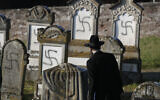Strasbourg chief Rabbi Harold Abraham Weill looks at vandalized tombs in the Jewish cemetery of Westhoffen, west of the city of Strasbourg, eastern France, December 4, 2019. (Jean-Francois Badias/AP)