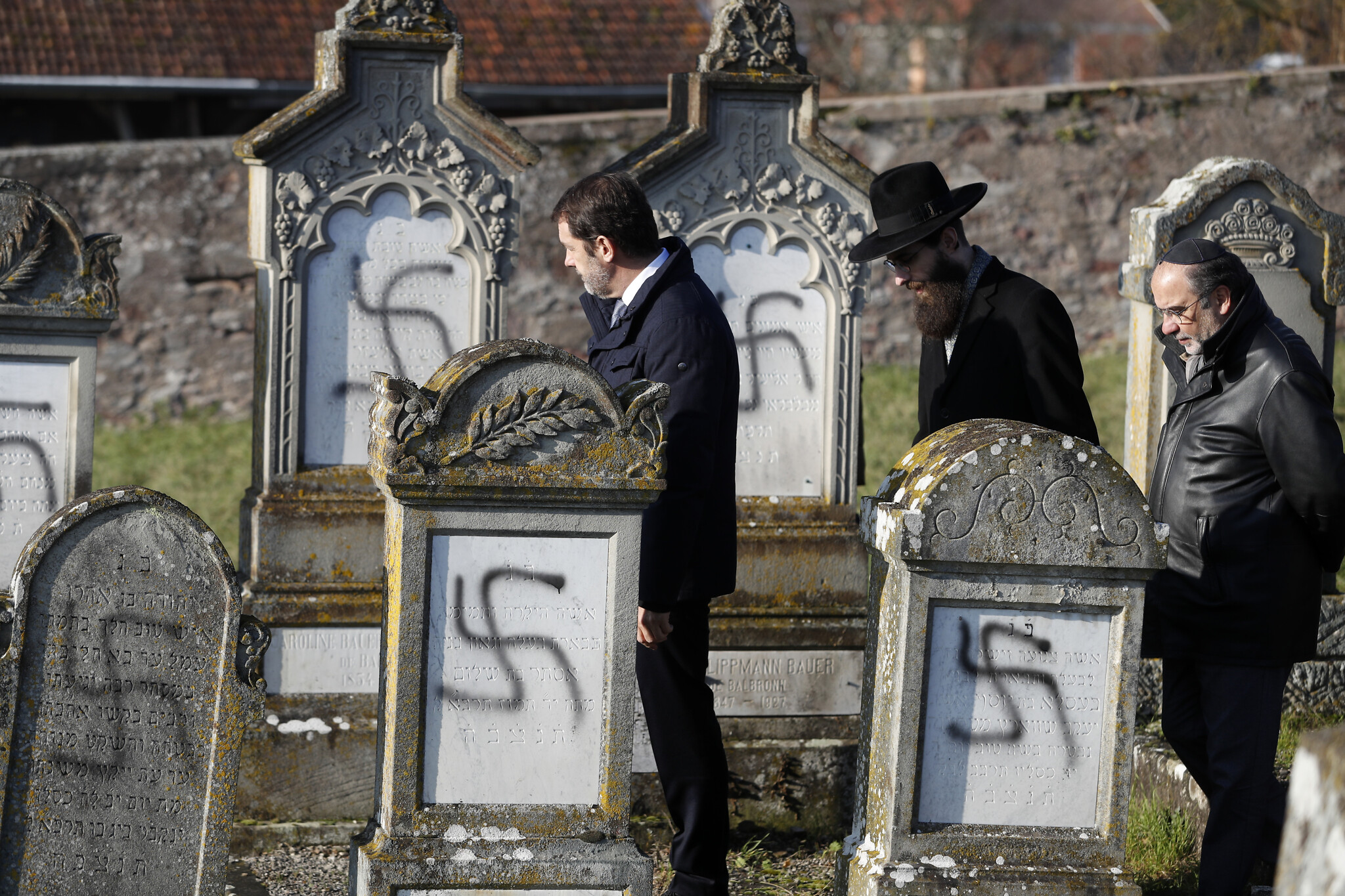 More than 100 graves vandalized with swastikas at Jewish cemetery in France